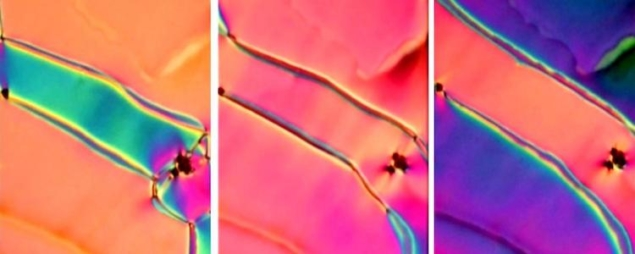 The colours in this newly discovered phase of liquid crystal shift as researchers apply a small electric field.