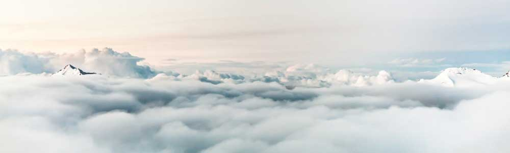 View of the sky from just above a layer of clouds