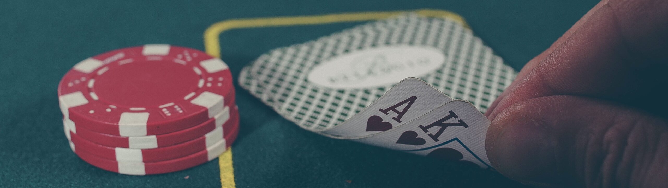 Poker table with chips and two cards, an Ace and King