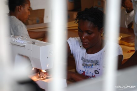 This woman is learning how to sew in World Concern's HIV support program in Haiti.