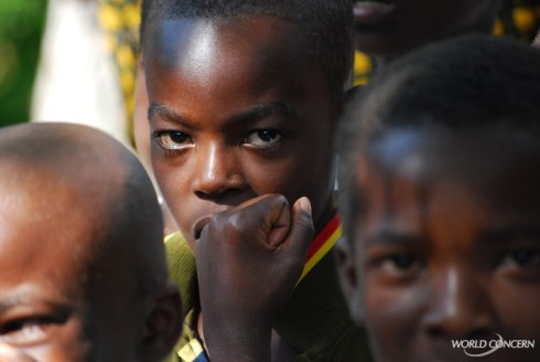 Haitian children wait for fruit trees, as World Concern helps feed families after 2008 hurricanes.