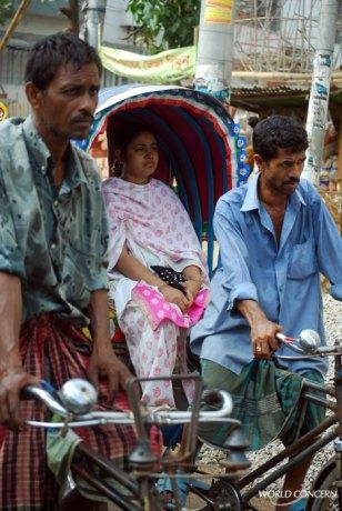 Men muscle 3-wheeled rickshaws through the streets of Dhaka, Bangladesh. The average income for a Bangladeshi: $1,500 a year.