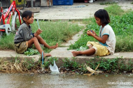 Girls play with each other along the Cambodia/Thailand border, an area popular among those who traffick children.