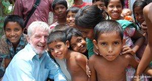 Richard Johannessen surrounded by children in Bangladesh.