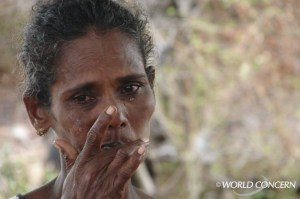A woman sheds tears in Sri Lanka.