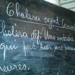 cholera information on a chalk board