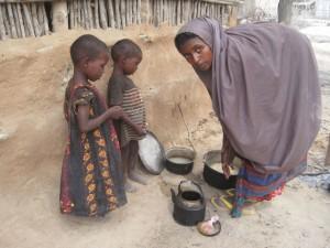 Preparing food in Somalia famine.