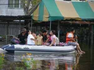 Families being evacuated during Thailand flooding.