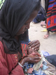 Somali mother giving baby water