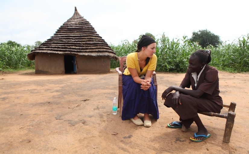 Jenny Simmons talks with a woman in South Sudan