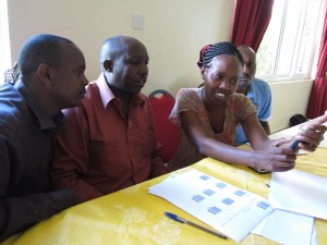 World Concern and partner agency staff practice scanning bar codes with their mobile phones during a training last week.