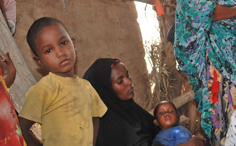 A widowed mother and her sons in Huluul, Somalia.