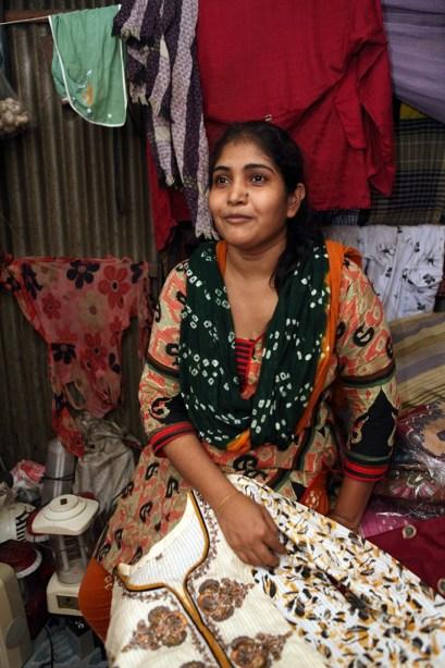 Lady holding clothing - Bangladesh