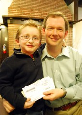 Jonathan handing over the check to Dave Eller, World Concern President at the time