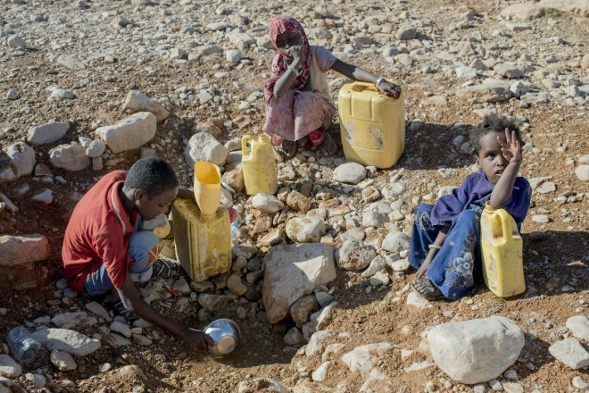 children gather water during severe drought in Somalia