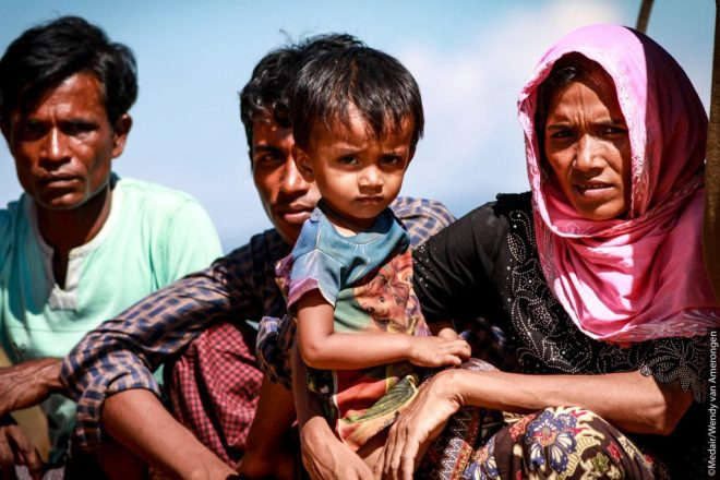 Rohingya refugee woman with her family
