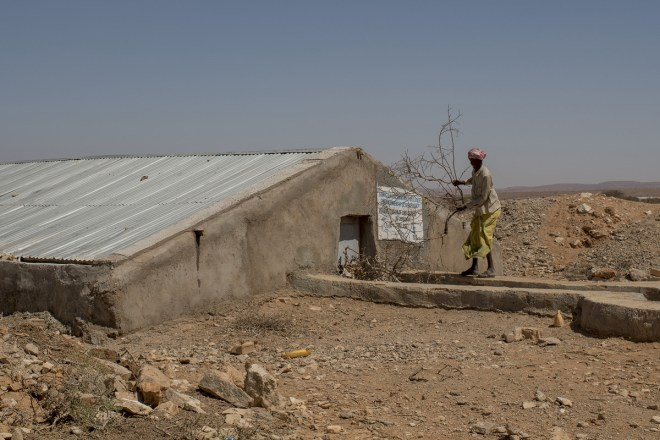 someone stands by a berkad that collects water in Somalia