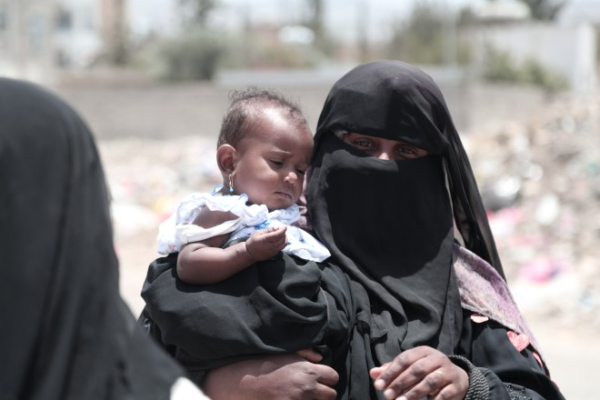 a woman in a veil holding her baby daughter