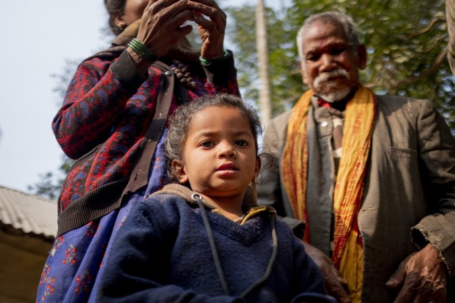 a little girl in Nepal is safe with her parents