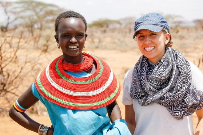 two moms standing next to each other in Kenya