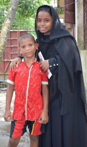 Shiphon and his teacher who is dedicated to giving children an education in Bangladesh.