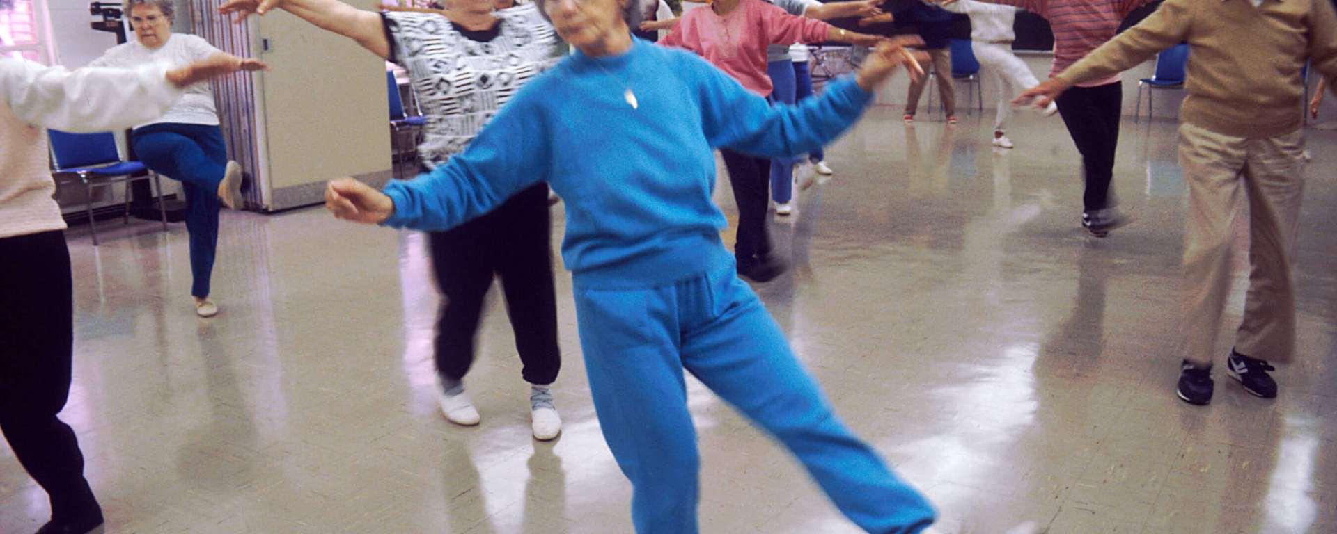 Elderly people exercising to music