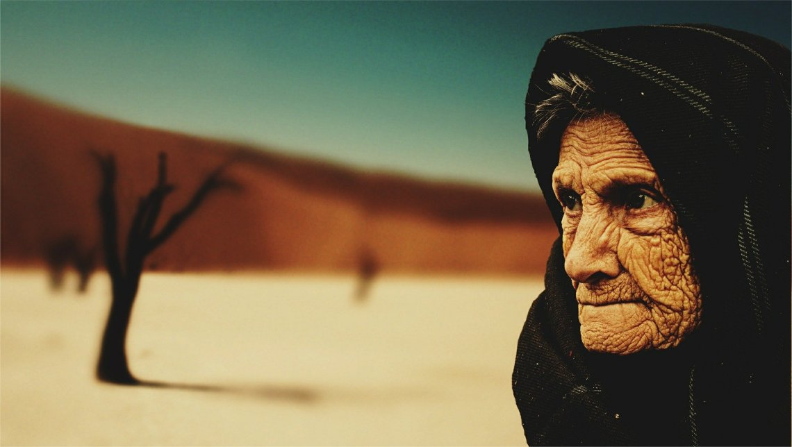 Old woman with desert background