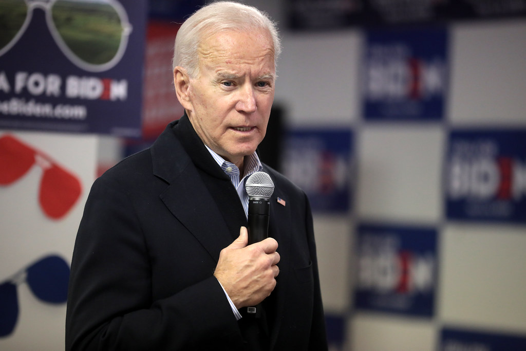 Joe Biden holding a mic whilst on stage during the presidential campaign