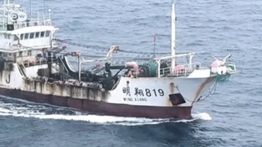 aerial photo of chinese trawler at sea