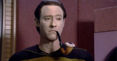 Close up of Star Trek's Data smoking a pipe