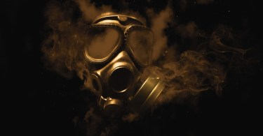 stylised photo of gas mask and smoke