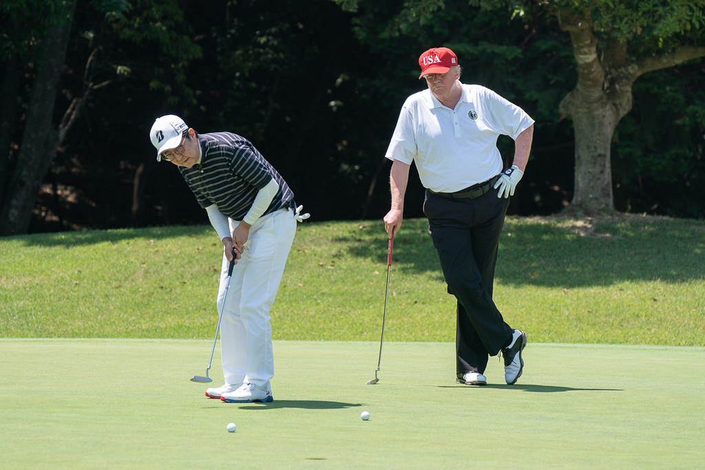 PM Abe and Trump playing golf