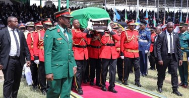 pall bearers carrying casket of Magufuli