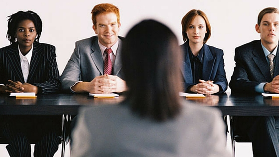job interview from perspective of interviewee looking at panel