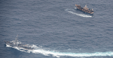 Ecuadorian navy ship maneuvering near chinese trawler