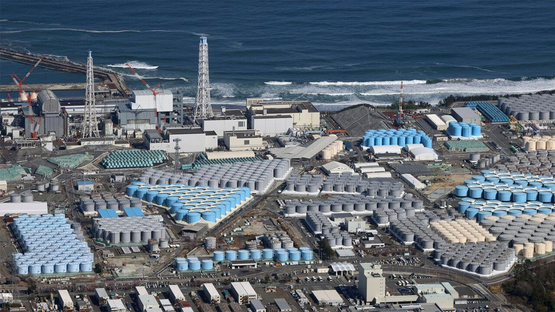 aerial shot of Fukushima nuclear plant showing the waste water tanks