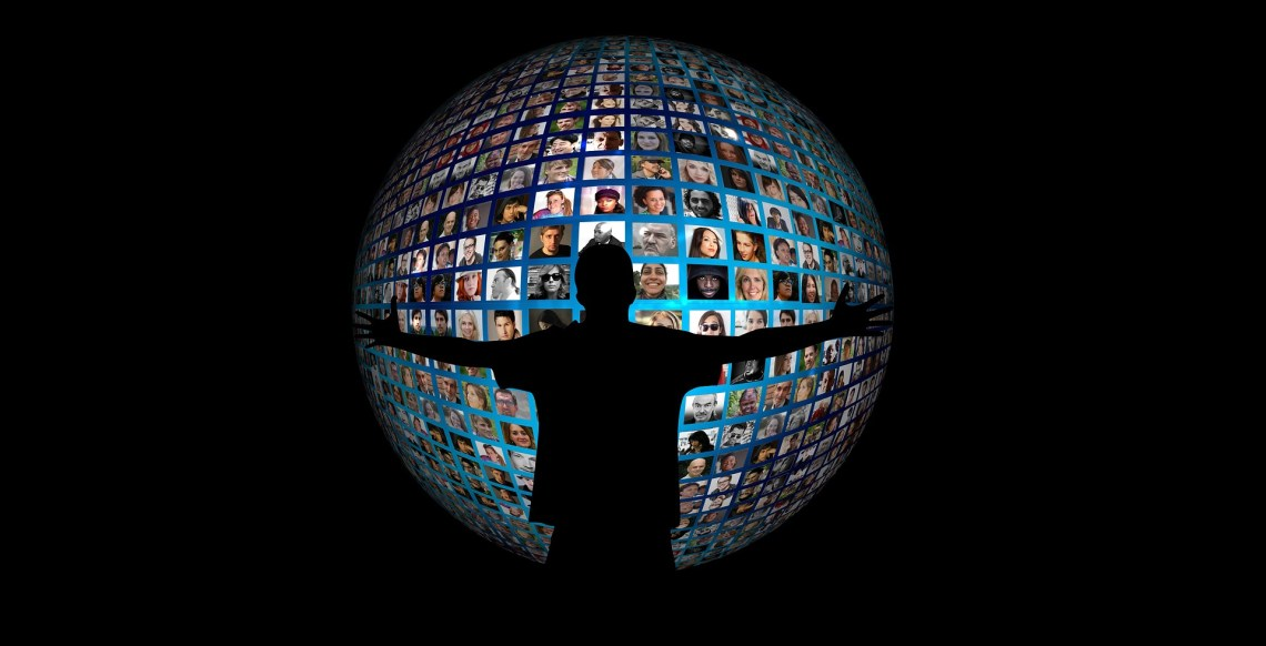 silhouetted figure with outstretched arms around globe with profile shots