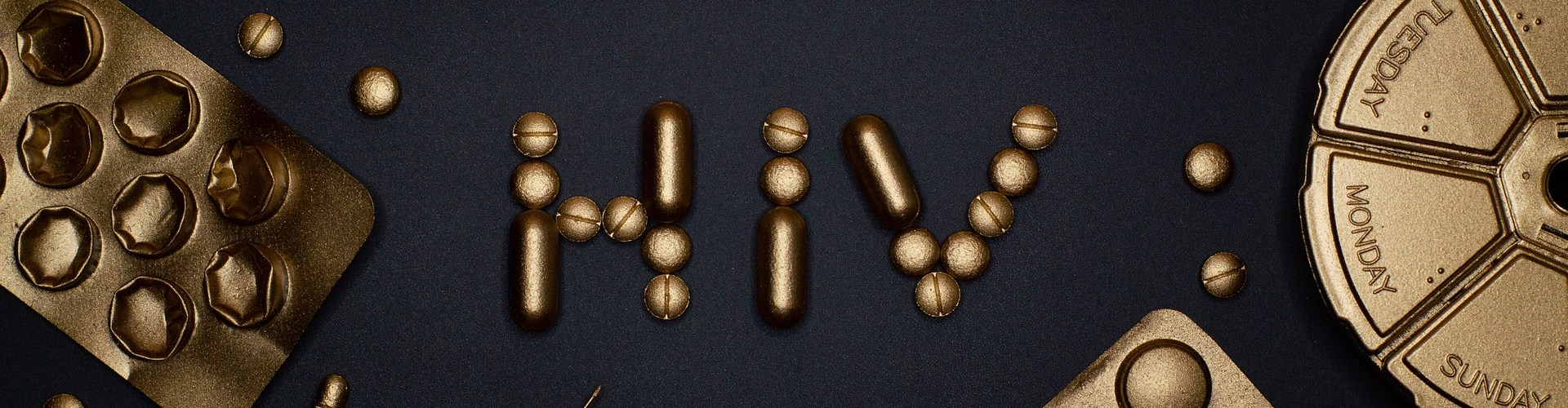 gold pills used to spell out HIV