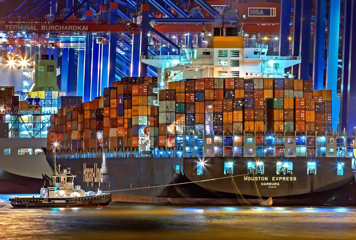 shipping container in port at night