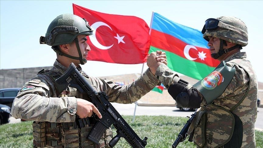 turkish and azerbaijani soldiers greet each other