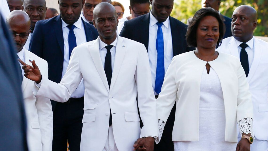 Fmr President Juvenal Moise and his wife in white suits