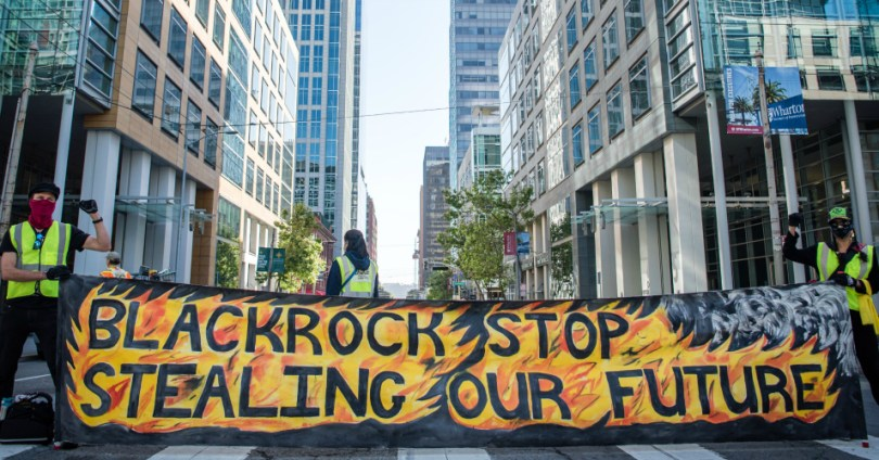 Activists gathered in San Francisco for a socially distanced protest targeting asset manager BlackRock.