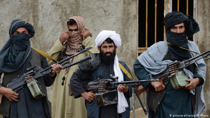 taliban fighters pose for the camera