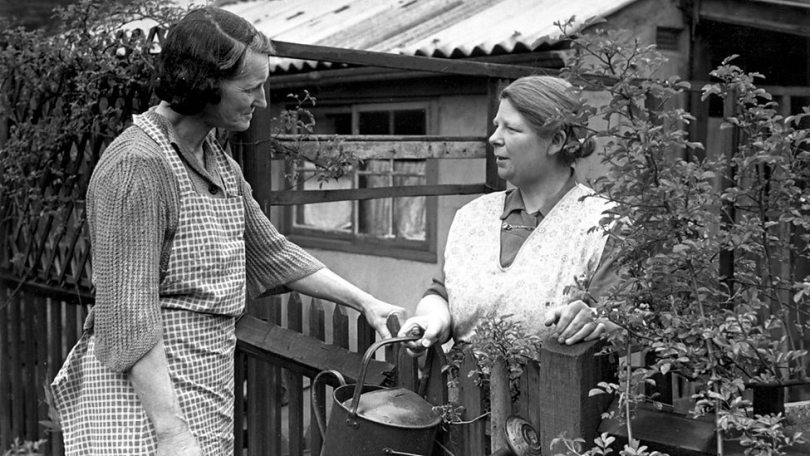 vintage photo of neighbours talking over fence