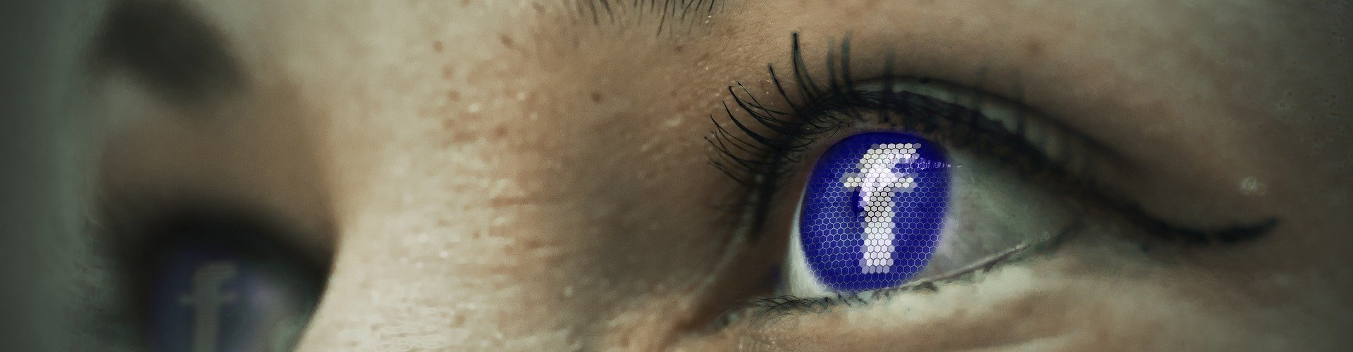 close up of woman's eyes with facebook icon reflected in on eye