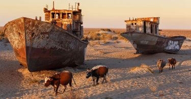 ships stranded on dried out lake bed