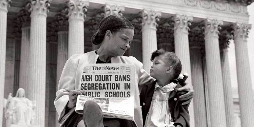 african american woman sitting on steps of supreme court with her daughter