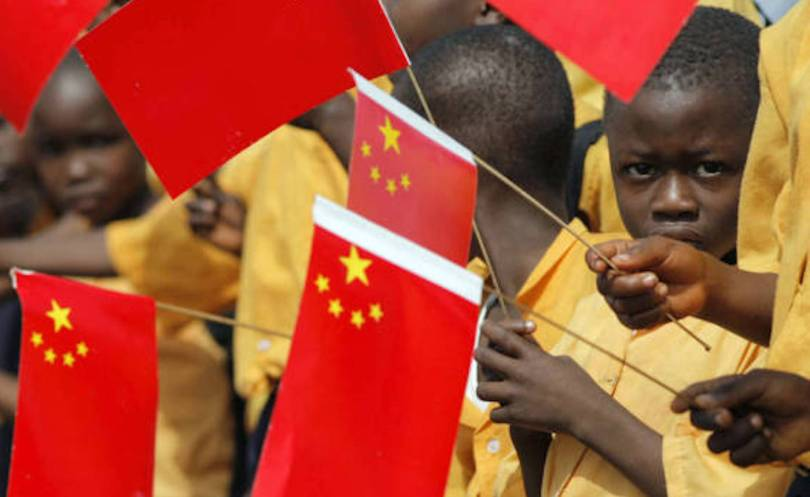 african children waving chinese flags