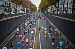 runners running on a city road in a race