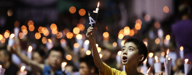 """Boy at the June 4 Vigil"". A Hong Kong memorial to mark the 25th anniversary of the  Tiananmen crackdown in Beijing. By Nora Tam. South China Morning Post"